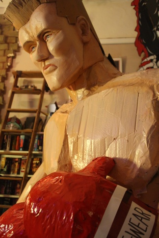 Artist Calder Greenwood (left) and A Martinez (right) pose with the top half of 12 foot cardboard Ivan Drago.