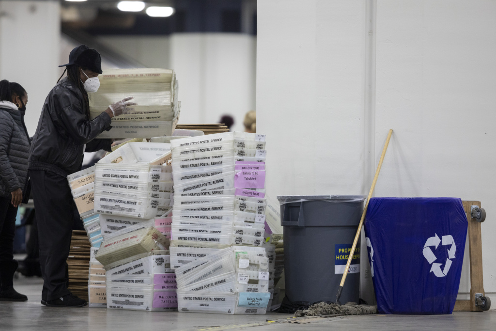 A worker with the Detroit Department of Elections helps stack empty boxes used to organize absentee ballots after nearing the end of the absentee ballot count at the Central Counting Board in the TCF Center on November 4, 2020 in Detroit, Michigan.