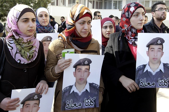 Anwar Tarawneh (C), the wife of Jordanian pilot Maaz al-Kassasbeh, who was captured by Islamic State (IS) group militants on December 24, takes part in a rally calling for the release of her captive husband in the Jordanian capital Amman on February 3, 2015.