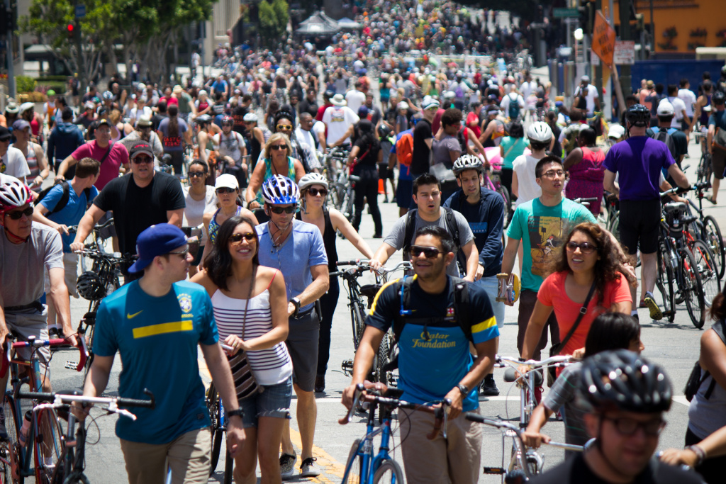 Cyclists and pedestrians climb Wilshire Boulevard in downtown L.A. during the seventh CicLAvia event on June 23, 2013.