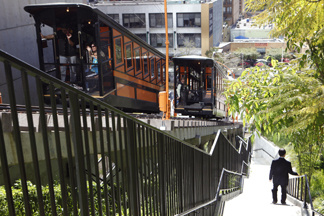 "A man walks down hill as the Angels Flight Railway, the so-called ""Shortest Railway in the World"" resumes ferrying passengers up and down Bunker Hill in downtown Los Angeles Monday March, 15, 2010. The funicular that shut down nine years ago after a deadly accident, resumed service this year."