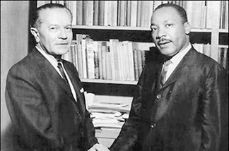 Rabbi Max Nussbaum and Dr. Martin Luther King Jr. shake hands during King's 1965 visit.