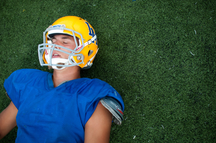 Kevin Dillman, 16, of La Mirada High School's Matadores varsity football team closes his eyes as he stretches on the field before practice in La Mirada, Wednesday, September 5, 2012. A native of Sweden, Dillman plans to pursue his dream into college football and later make it his career in the National Football League.