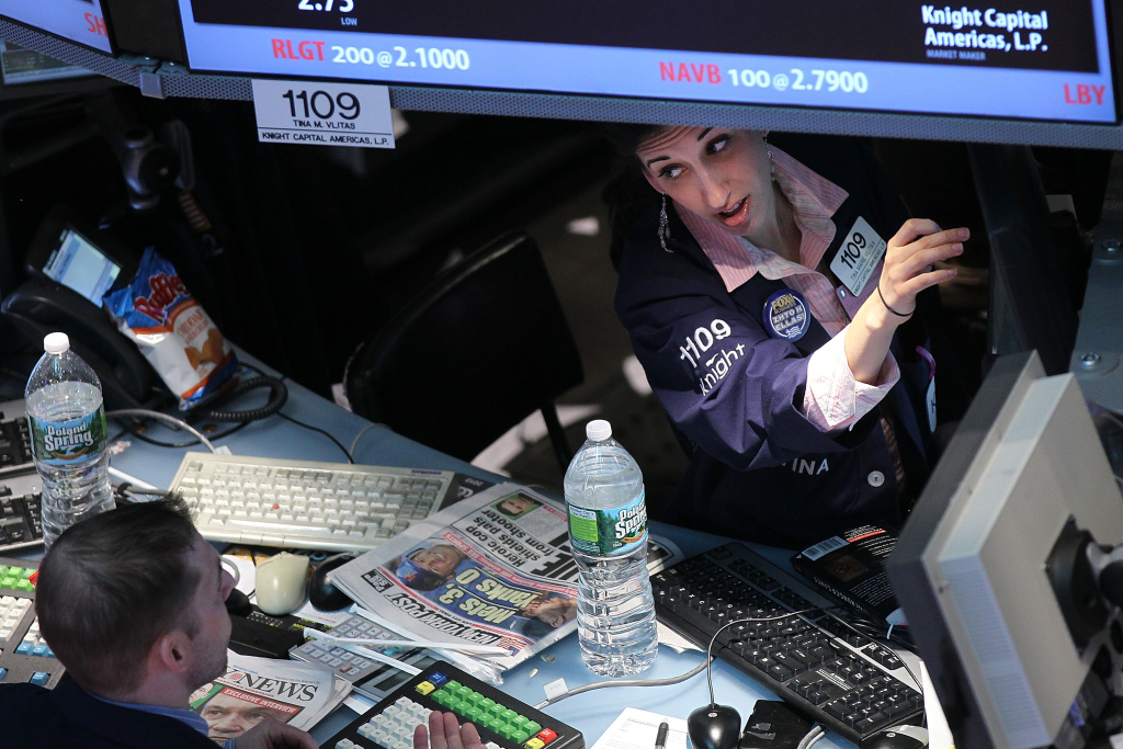 NEW YORK, NY - APRIL 09: Traders work on the floor of the New York Stock Exchange on April 9, 2012 in New York City.  Following a poorer than expected jobs report last Friday, stocks fell with The Dow Jones industrial average down 147 points, or 1.2%, in midday trading.