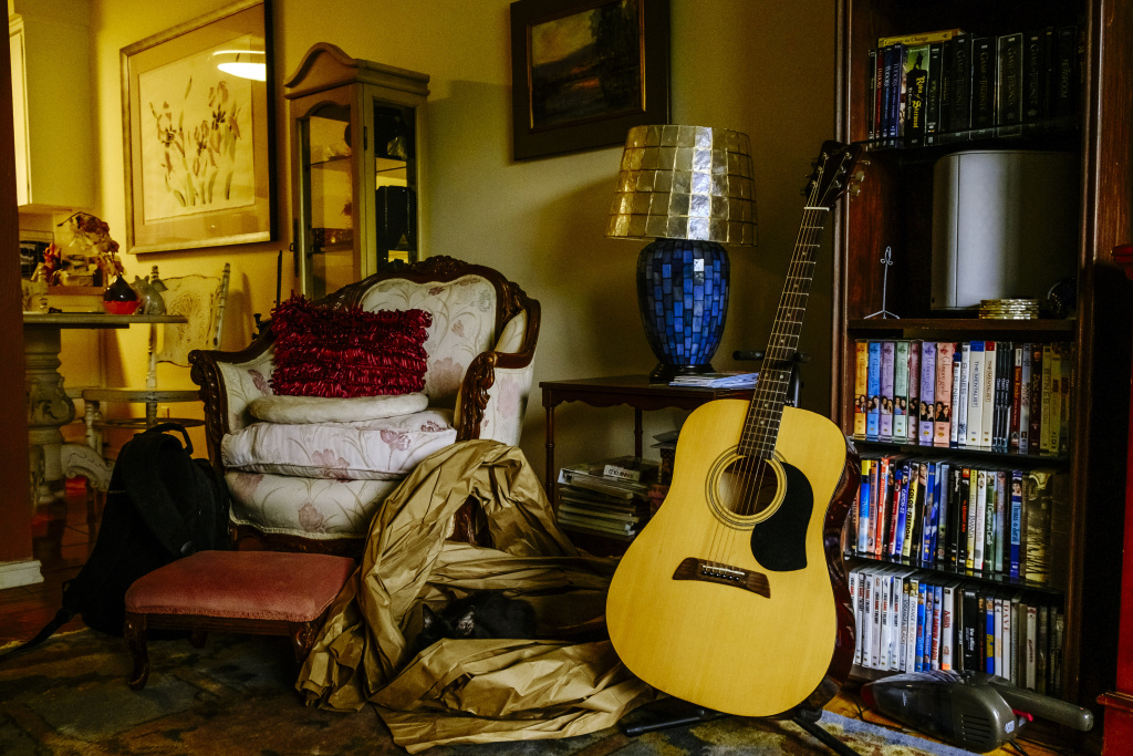 Audrey Woolfolk keeps an acoustic guitar in her living room. Growing up, Julie used to take guitar lessons and loved playing music.