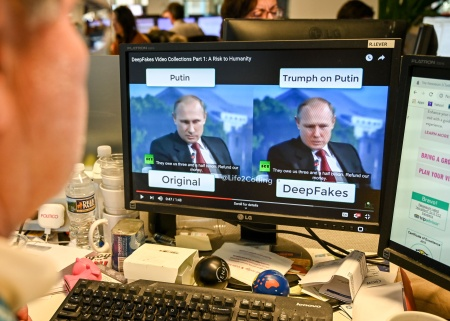 "A AFP journalist views a video on January 25, 2019, manipulated with artificial intelligence to potentially deceive viewers, or ""deepfake"" at his newsdesk in Washington, DC."