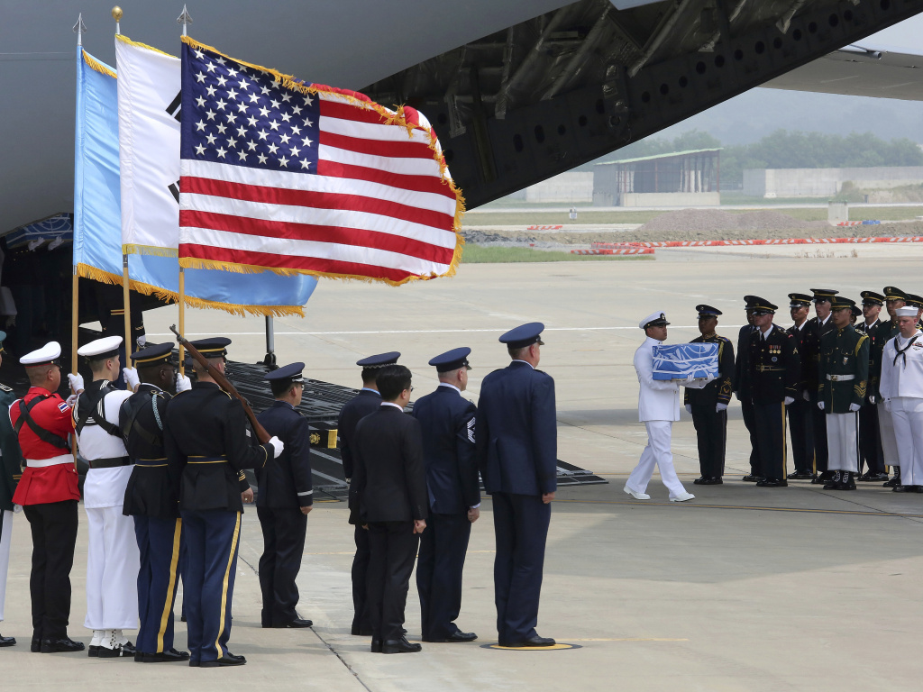 A U.N. honor guard carries a box containing remains believed to be from American servicemen killed during the 1950-53 Korean War after arriving from North Korea, at Osan Air Base in Pyeongtaek, South Korea on Friday.