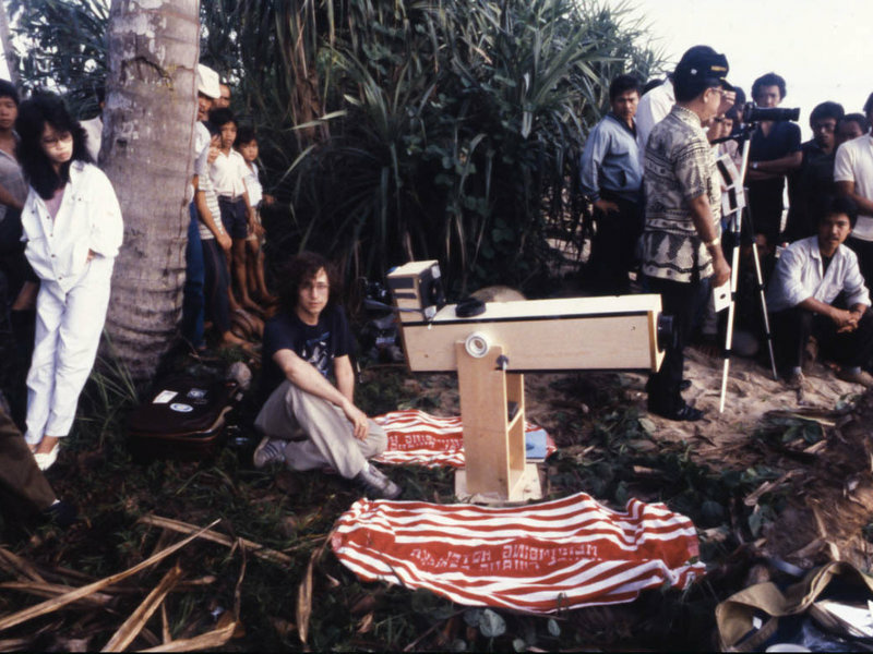 Astronomer Glenn Schneider (center) was on the coast of Bangka Island, Indonesia, on March 18, 1988, preparing to observe and photograph that day's total solar eclipse using his