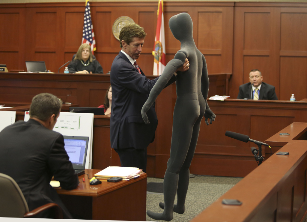 Defense attorney Mark O'Mara (2nd R) uses a foam dummy to describe the altercation between George Zimmerman and Trayvon Martin to defense witness and law enforcement expert Dennis Root (R) during Zimmerman's murder trial in Semimole circuit court on July 10, 2013 in Sanford, Florida.