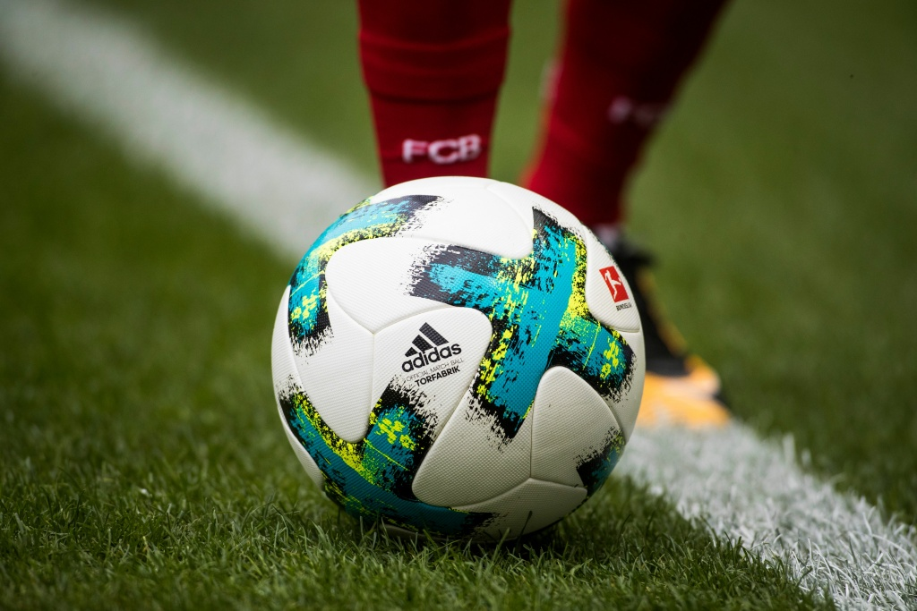 Soccer player walks with the ball during a Berlin vs Bayern Munich match at the Olympic stadium in Berlin.