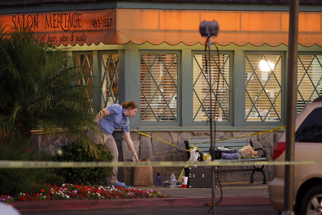 Investigators collect evidence at Salon Meritage hair salon where a man shot nine people, killing eight of them, on October 12, 2011, in Seal Beach, California.