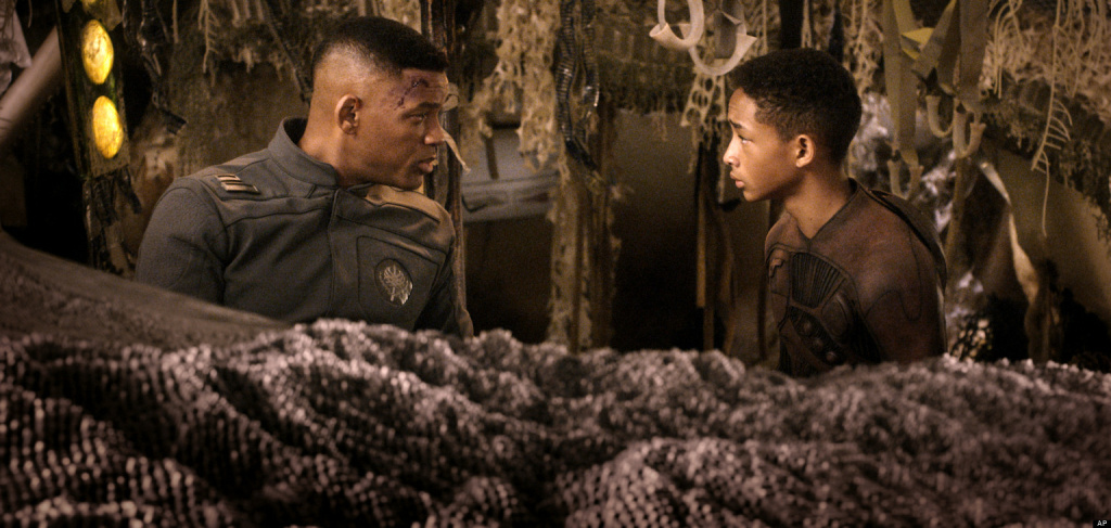 This film publicity image released by Sony - Columbia Pictures shows Will Smith, left, and Jaden Smith in a scene from