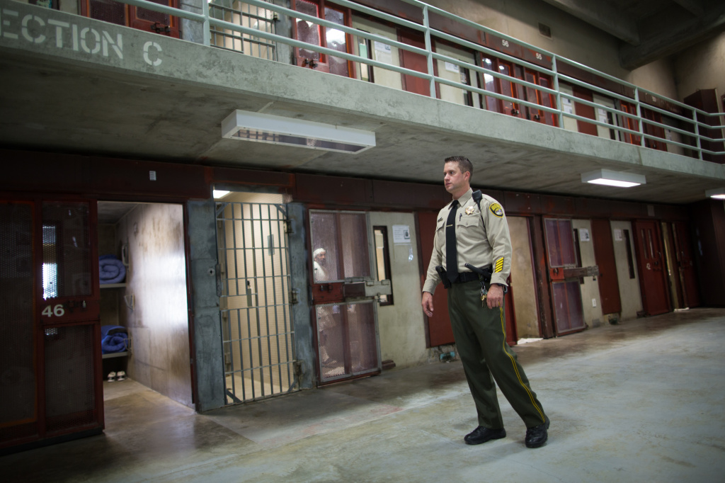 Officer Vickjord walks the floor of the 4B SHU at Corcoran State Prison.