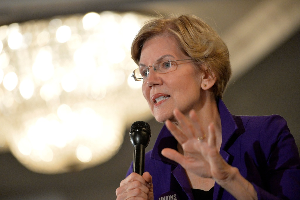 Democratic presidential hopeful Massachusetts' Senator Elizabeth Warren speaks to members of SEA/SEIU Local 1984, state employees, at the Holiday Inn in Concord New Hampshire, after signing papers to officially enter the New Hampshire Primary race on November 13, 2019.