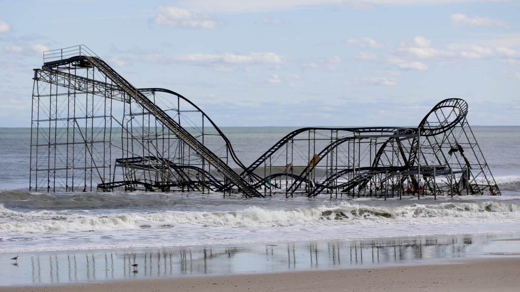 A rollercoaster that once sat on the Funtown Pier in Seaside Heights, N.J., rests in the ocean on Wednesday, Oct. 31, 2012 after the pier was washed away by superstorm Sandy.