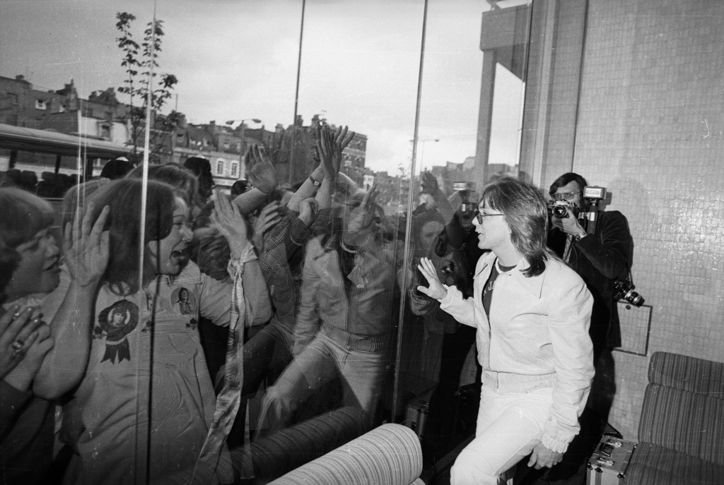 File: Hordes of screaming girls are separated from their idol David Cassidy by a pane of glass at the Thames television studio in London on May 25, 1974.