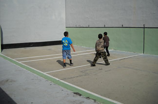 Children play at a handball clinic at the historic Maravilla handball court in East L.A.