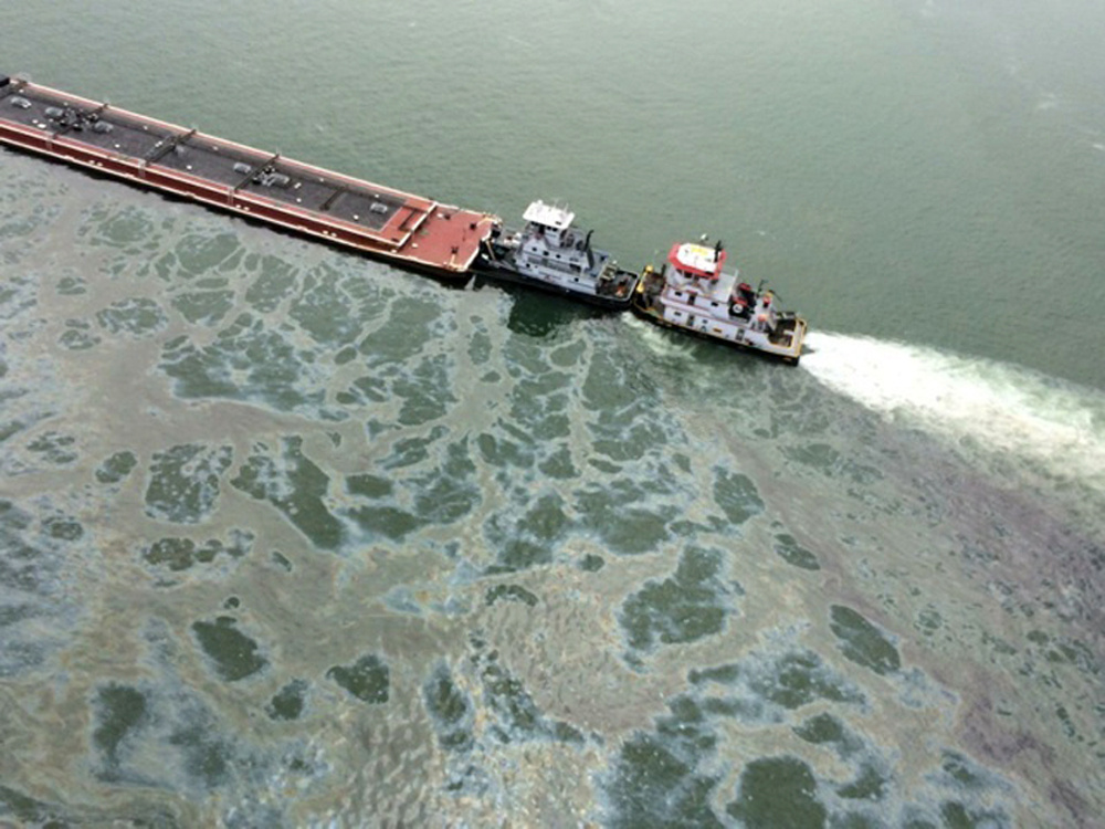 A barge loaded with marine fuel oil sits partially submerged in the Houston Ship Channel, March 22, 2014. The bulk carrier Summer Wind, reported a collision between the Summer Wind and the barge, containing 924,000 gallons of fuel oil. The barge collided with a ship in Galveston Bay on Saturday, leaking an unknown amount of the fuel into the popular bird habitat as the peak of the migratory shorebird season was approaching.
