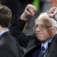 Democratic presidential candidate Sen. Bernie Sanders of Vermont pumps his fists as he leaves the field after speaking at a rally in Seattle on March 25, 2016.