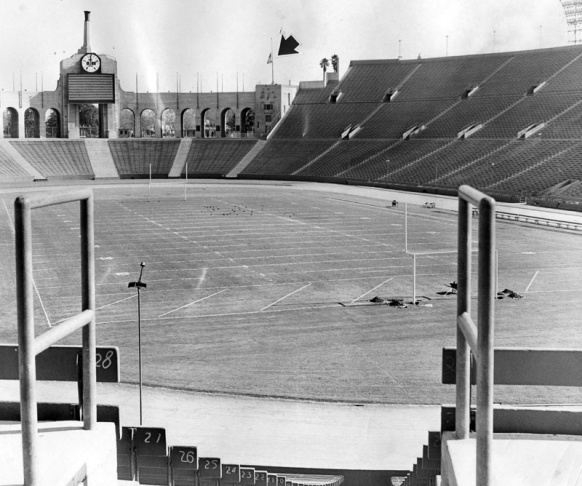 November 23, 1963. Officials at the Los Angeles Memorial Coliseum cancelled a scheduled USC-UCLA football game because of the assassination of President John F. Kennedy, leaving the stadium empty and its flags flown at half mast. Just three years earlier, Kennedy accepted the Democratic Party's nomination for president at the same site.