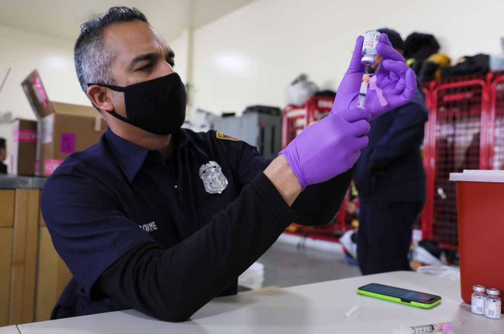 Firefighter paramedic Alexander Gorme prepares a COVID-19 vaccination dose at a fire station on January 29, 2021 in Los Angeles, California.