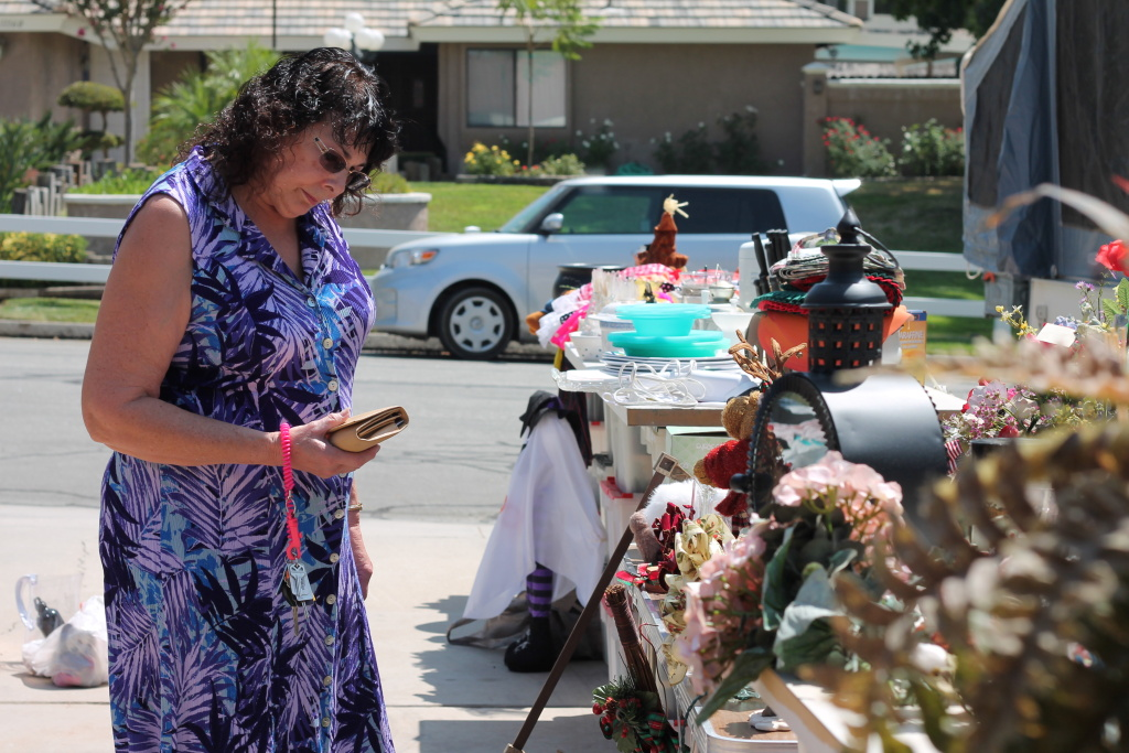 A potential customer takes a look at the items at Elguera's yard sale.