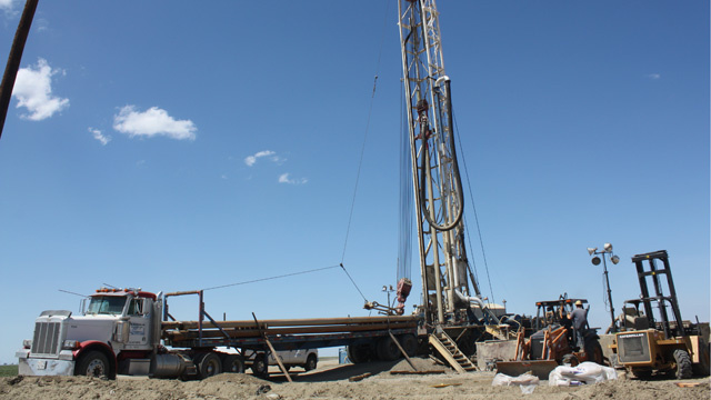 Drillers are bringing in large rigs like this one from all over the west, to drill deeper wells in the quest for water.