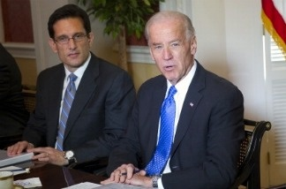 US Vice President Joe Biden (2nd R) speaks during a meeting of bipartisan members of Congress to begin work on a legislative framework for comprehensive deficit reduction at Blair House, across the street from the White House in Washington, DC, on May 5, 2011.  US Representative Eric Cantor listens.