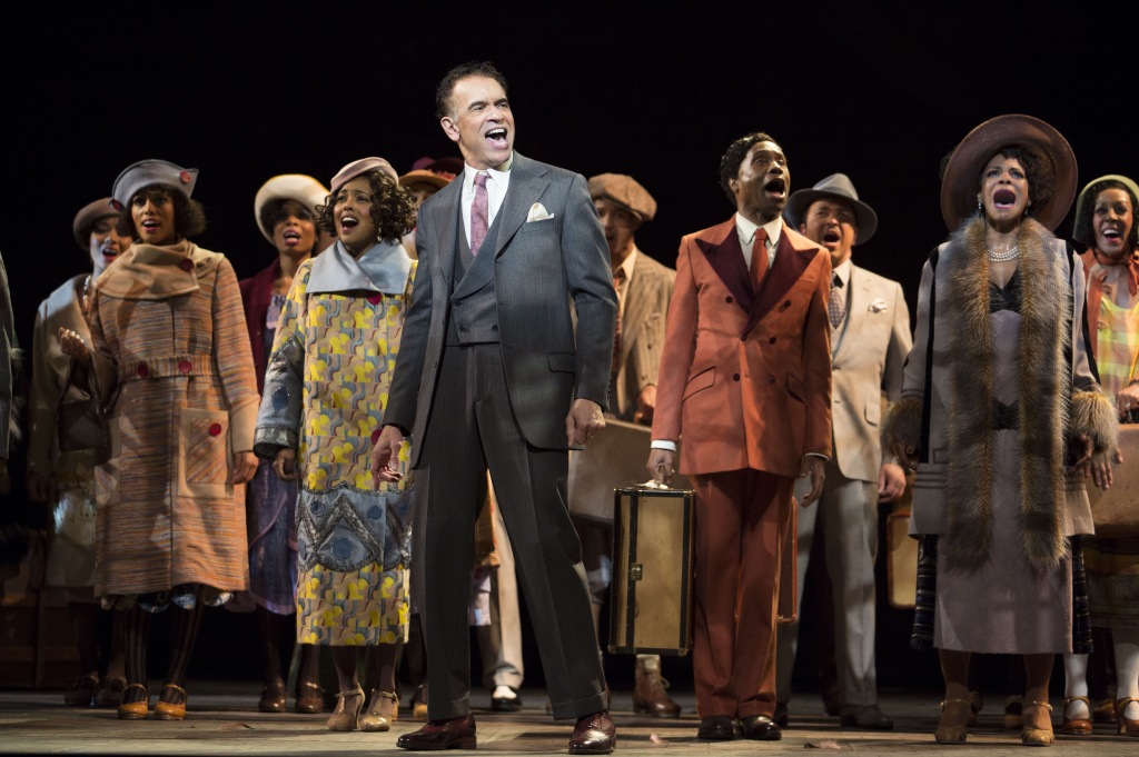 Brian Stokes Mitchell (center), in
