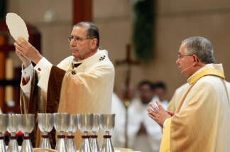 File photo:  Cardinal Roger Mahony (L) offers the Eucharist while Archbishop Jose H. Gomez looks on during a welcoming Mass at the Cathedral of Our Lady of the Angels May 26, 2010 in Los Angeles, California.