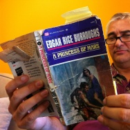 David Kipen, founder of Libros Schmibros in Boyle Heights, perusing one of the books that shaped Mars in pop culture and lit.