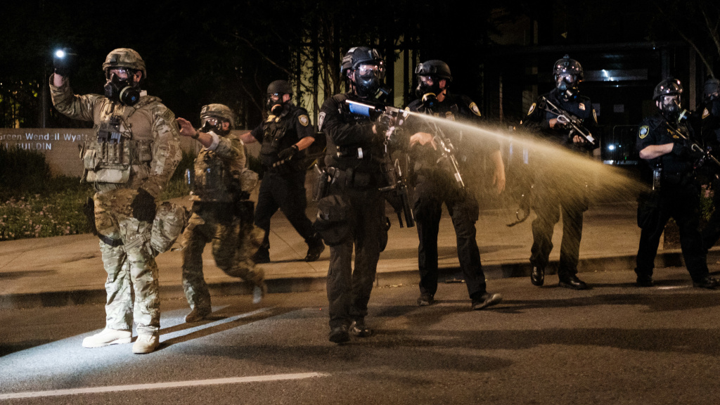 Federal officers use tear gas and other crowd dispersal munitions on protesters outside the Multnomah County Justice Center on July 17, 2020 in Portland, Oregon.