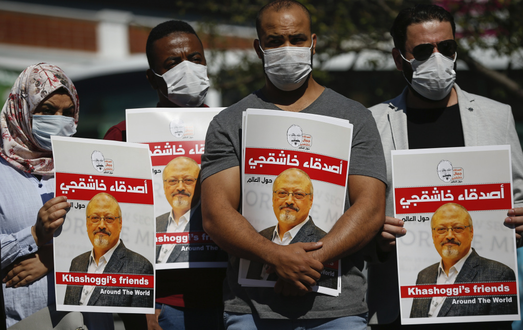 People hold posters of slain Saudi journalist Jamal Khashoggi, near the Saudi Arabia consulate in Istanbul, marking the two-year anniversary of his death last October.