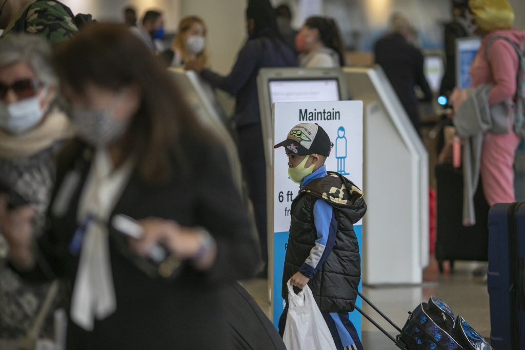 Holiday travelers pass through Los Angeles international Airport on Thanksgiving eve as the COVID-19 spike worsens and stay-at-home restrictions are increased on November 25, 2020 in West Hollywood, California.
