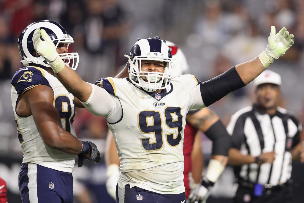 Defensive end Aaron Donald #99 of the Los Angeles Rams reacts after a tackle against the Arizona Cardinals during the second half of the game on December 3, 2017 in Glendale, Arizona. The Rams defeated the Cardinals 32-16.