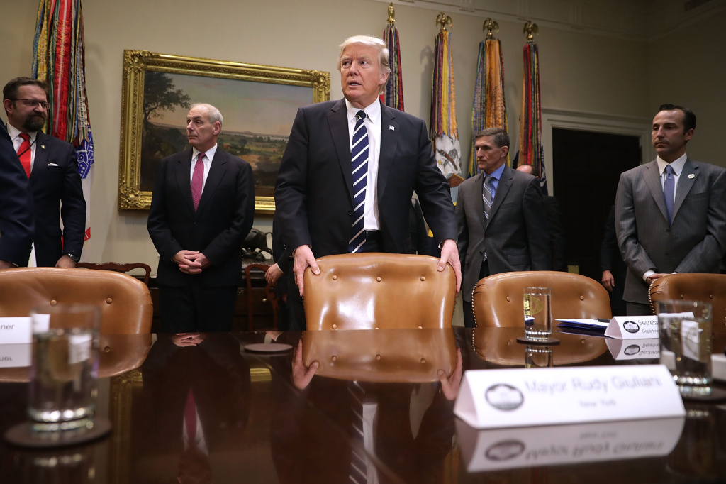 U.S. President Donald Trump (C) arrives for a meeting with government cyber security experts in the Roosevelt Room at the White House January 31, 2017 in Washington, DC.
