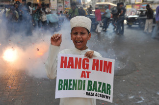 A young Muslim child shouts anti-Pakistan slogans in India on May 6, 2010