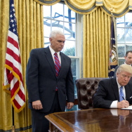 President Trump signs the executive orders in the Oval Office on Monday, including a withdrawal from the Trans-Pacific Partnership trade deal.
