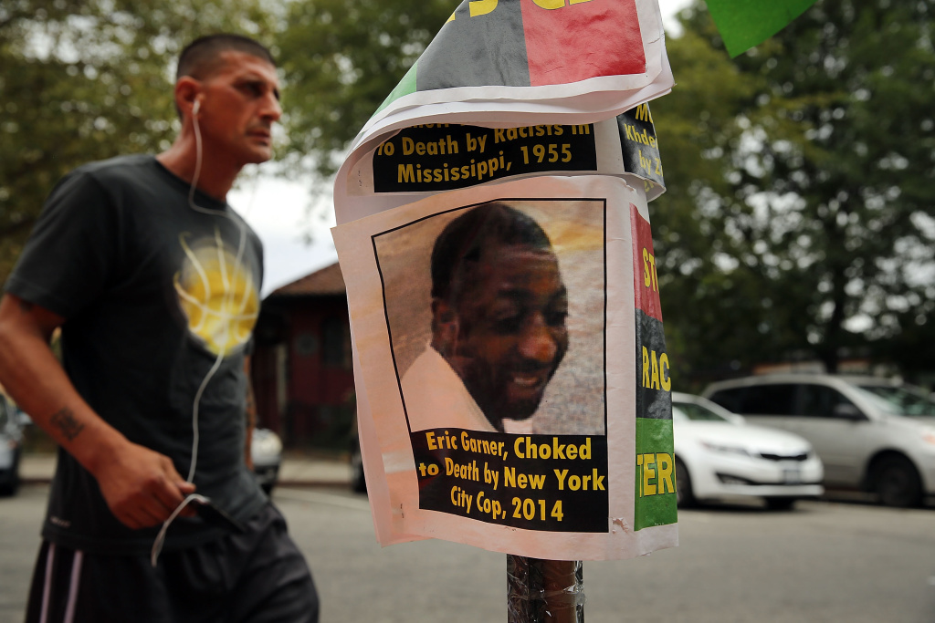 File: A flyer with a picture of Eric Garner is seen near where he was killed in an encounter with an NYPD officer in July on Aug. 22, 2014 in the borough of Staten Island in New York City.