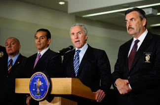 Los Angeles Dodgers owner Frank McCourt (2nd-R)speaks as Los Angeles Police Department Chief Charlie Beck (R) Los Angeles Mayor Antonio Villaraigosa (2nd-L) and Councilman Ed Reyes (L) look on, during a Dodger Stadium security news conference at Los Angeles Police Department headquarters on April 8, 2011 in Los Angeles, California.