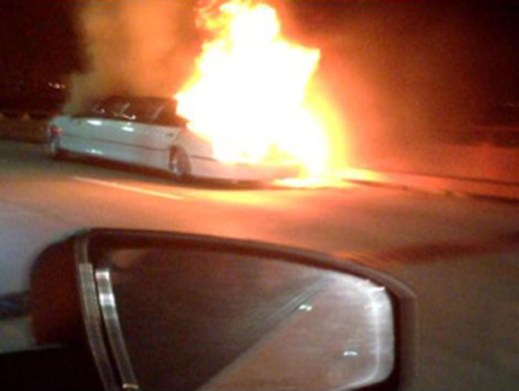 FILE - This frame grab taken from video provided by Roxana and Carlos Guzman shows a Limo on fire Saturday, May 4, 2013, on the San Mateo-Hayward Bridge in San Francisco. Prosecutors, coroner's officials and the California Highway Patrol present on Monday Aug.19, 2013  the results of their investigation of a limousine fire that killed five women in San Francisco.