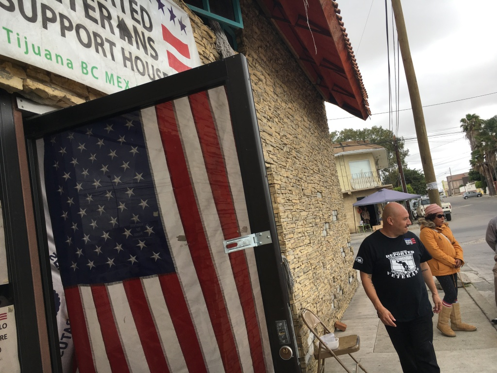 On the sidewalk outside the Deported Veterans House in Tijuana, Army veteran Hector Barajas meets with new arrivals. The House has a database of 350 deported veterans, but Barajas estimates the number could be much higher.