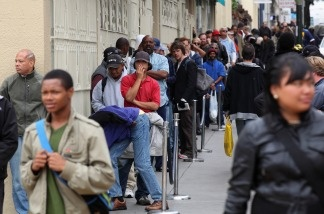 People line up to receive a free meal at the St. Anthony foundation dining room on September 16, 2010 in San Francisco, California. The U.S. poverty rate increased to a 14.3 percent in 2009, the highest level since 1994.
