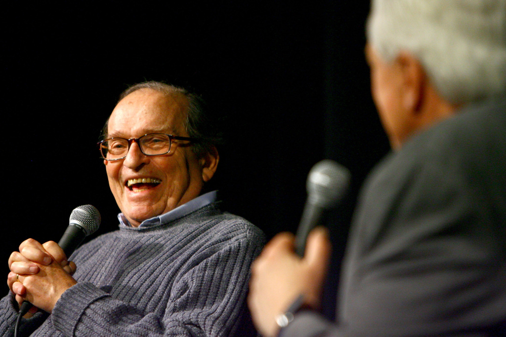 Turner Classic Movies host Robert Osborne (R) participates in a conversation with Director Sidney Lumet after a screening of Lumet's movie Network.