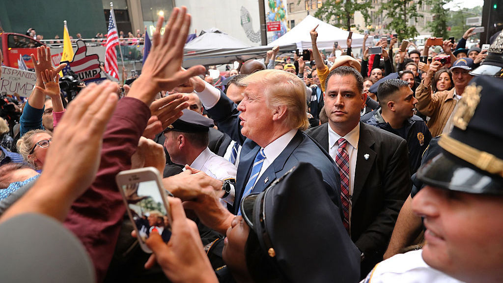 Donald Trump greets supporters outside of Trump Towers in Manhattan October 8, 2016 after a 2005 video revealed lewd comments Trump made about women.