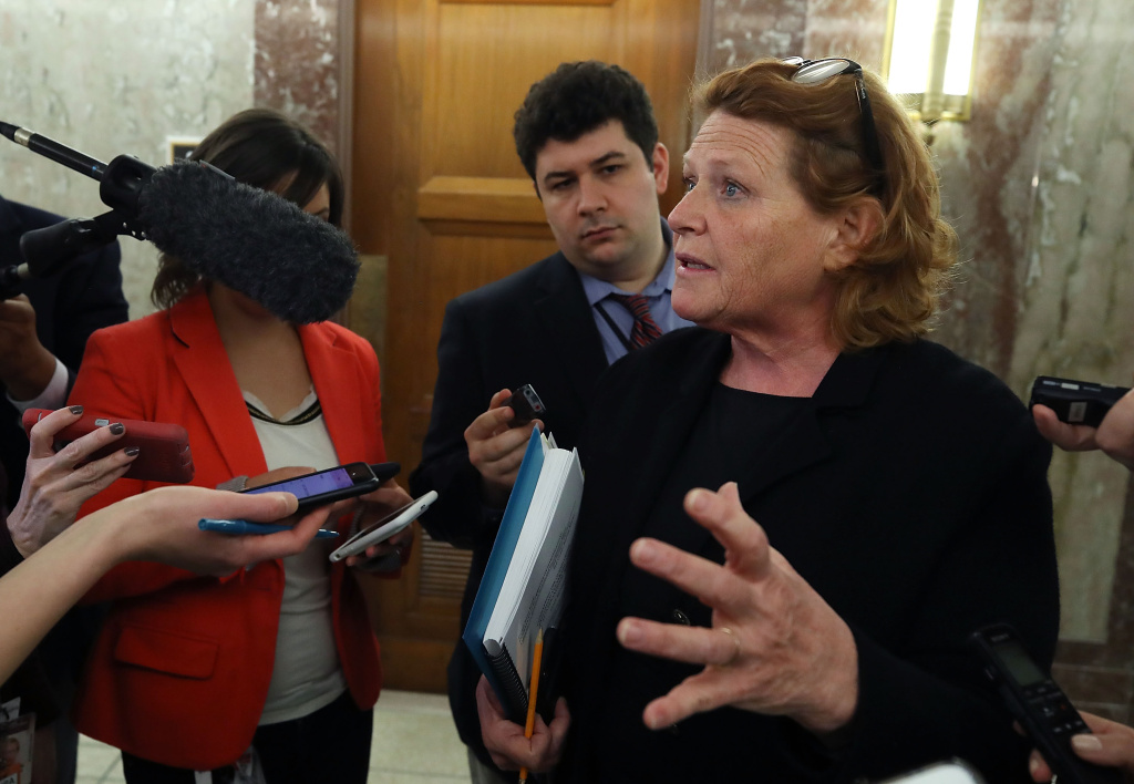Sen. Heidi Heitkamp speaks to the media about immigration on Capitol Hill on January 25, 2018.