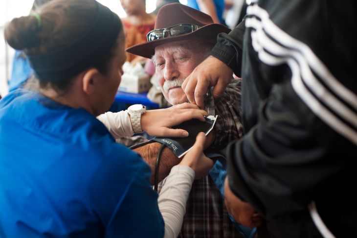 Nursing students check blood pressure during Care Harbor's annual Los Angeles medical clinic at the Los Angeles Memorial Sports Arena on Thursday, Oct. 31.
