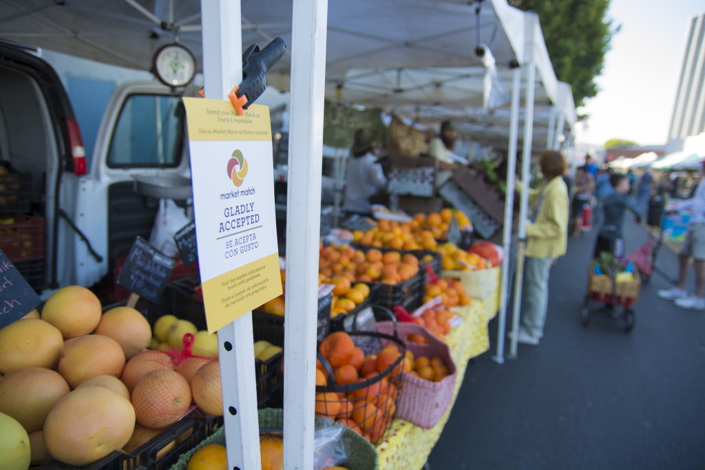 File: A flyer at the Hollywood Farmers Market advertises the Market Match program, which provides extra money to some EBT shoppers.