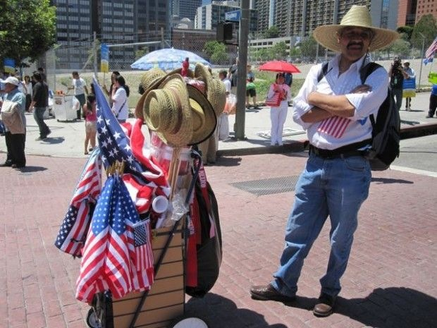 American flags and wide-brimmed hats for sale at a May Day immigrant rights rally in downtown L.A., May 1, 2011