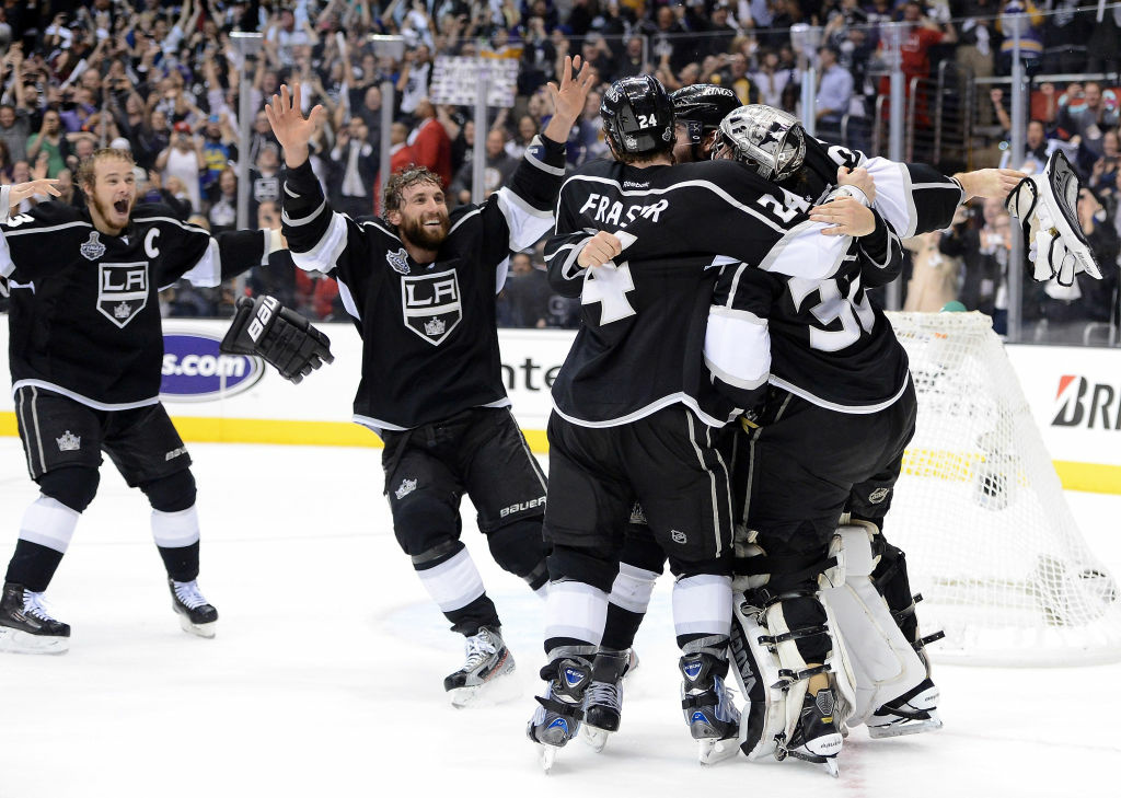 (L-R) Captain Dustin Brown #23, Jarret Stoll #28, Colin Fraser #24, Drew Doughty #8 of the Los Angeles Kings surround goaltender Jonathan Quick #32 of the Los Angeles Kings after winning Game Six of the 2012 Stanley Cup Final 6-1 to win the series 4-2 at Staples Center on June 11, 2012 in Los Angeles.